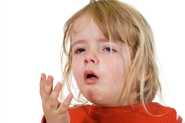 Little girl coughing with the flu