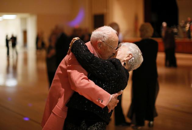 Elderly Couple Kiss