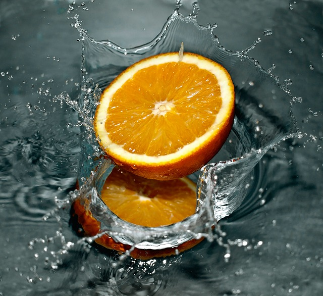 orange splashing into water