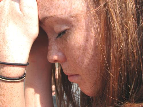 girl suffers from bad headache